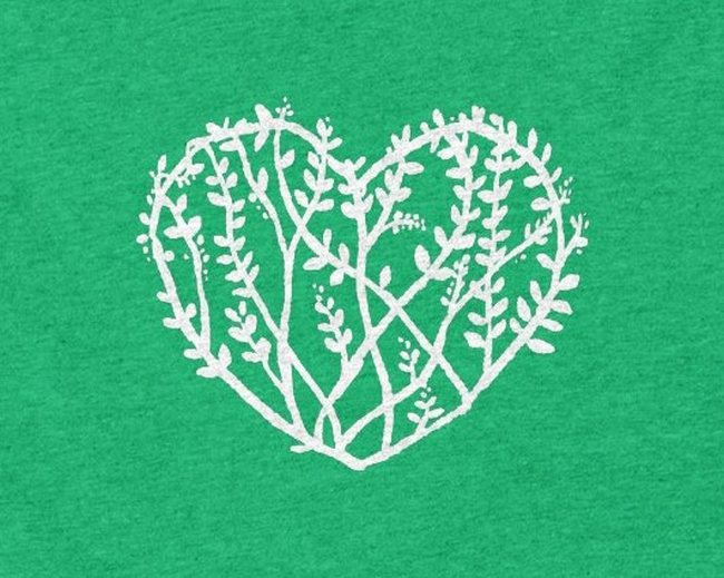 A heart made of plants and vines.